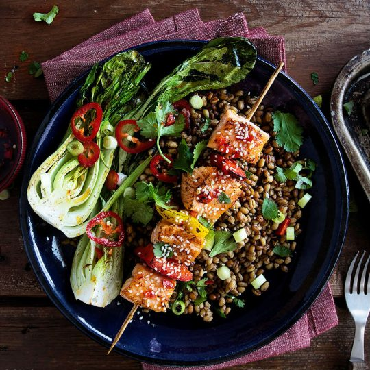 Sticky Asian style salmon skewers with Chinese Spelt